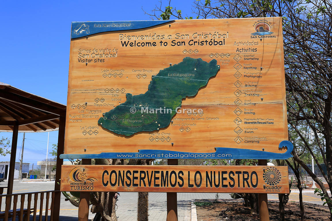 Welcome sign to San Cristobal with map of the island, outside San Cristobal airport, San Cristobal, Galapagos