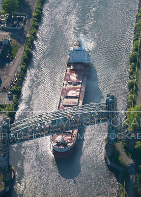 Ship Passing Under Raised Bridge
