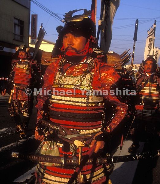 Samurai marching in prebattle ceremony, pray for victory. Yonezawa.