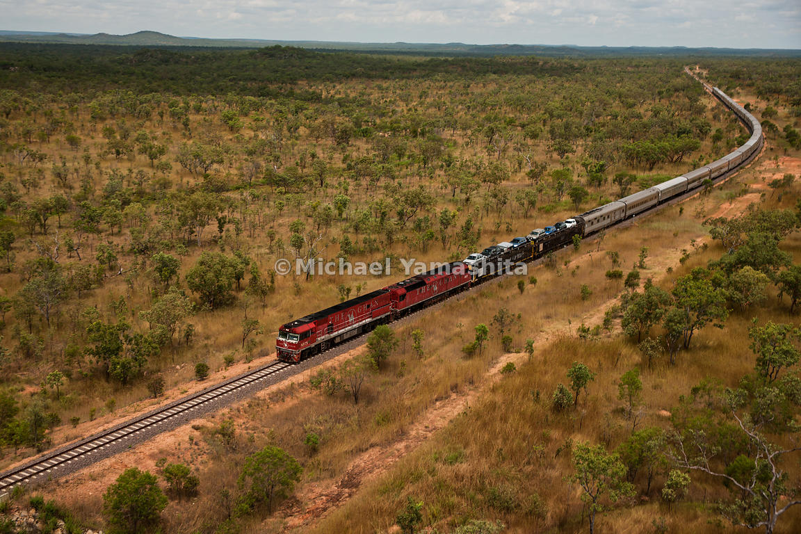 The Ghan, Australia's most famous train, 80 years operating between Adelaide and Darwin cutting the country in half. Takes 3 days, 2nights to travel the 2979km.,acoss the outback.. 3 classes of service: Red, reclining seats; Gold w single and 2 berth cabins; Platinum w luxury suites.. Features 2 dining cars, 2 lounge salon cars. This train almost a km long. Pics from Katherine to Darwin by helicopter.