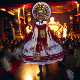 An actor leaps into the audience during a production of the Ramayana at the Kalamandalam