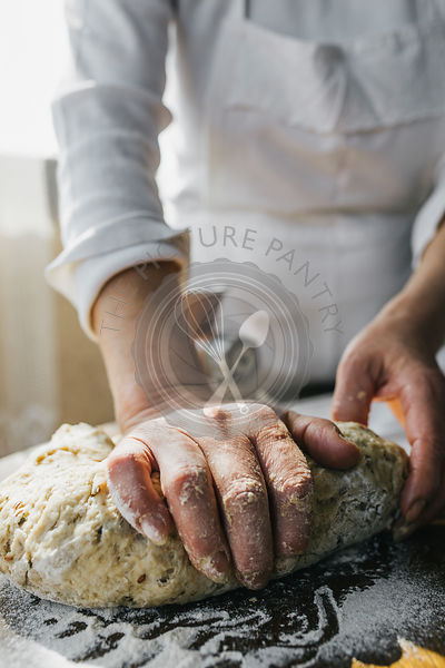 Woman Preparing Homemade Dough in the Kitchen and using a mincing machine. Preparation Raw Dough for Baking