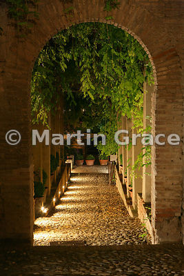 Illuminated pathway in the Generalife Gardens at night, Granada, Andalusia, Spain