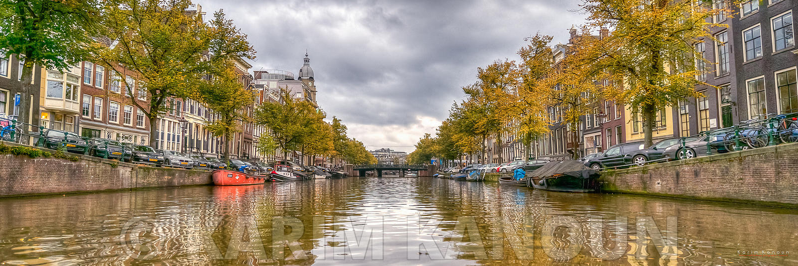 Panorama - Amsterdam river canal from a boat cruise on a rainy day