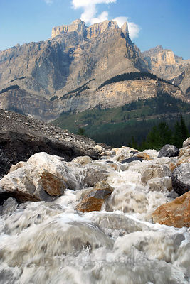 Wide-angle view of a glacier-fed creek with a heavy sediment load. Near the Athabasca Glacier, Jasper NP, Canadian Rockies.