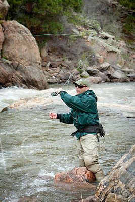 Fly fisherman casting.