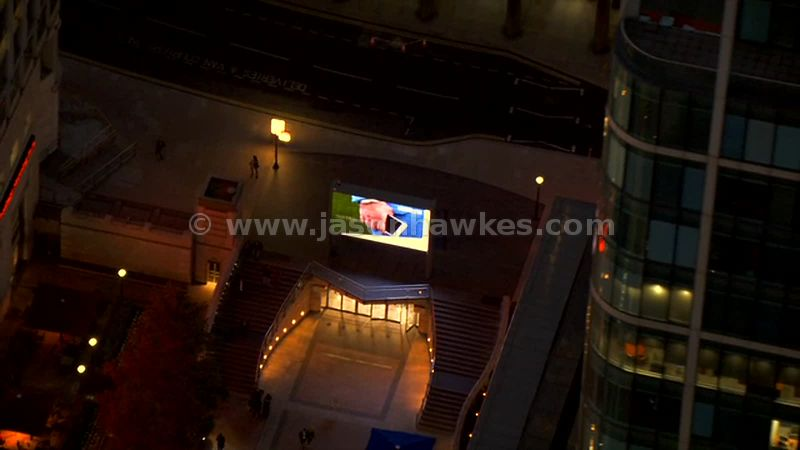 Aerial footage of Six Public Clocks at night, Canary Wharf, London