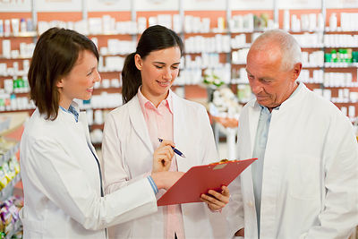 Smiling pharmacists talking in store