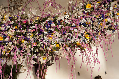 Section of the 60' long dried flower garland made from over 30,000 dried flowers and grasses inserted into a pittosporum base that hangs in the Great Hall at Christmas. Cotehele, St Dominick, nr Saltash, Cornwall, UK