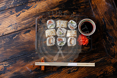 Sushi rolls Yin Yang shape on wooden background