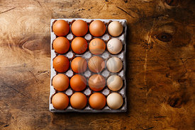 Fresh brown and speckled chicken Eggs in eco cardboard paper tray container