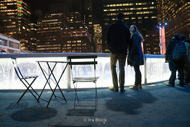 A couple at the ice rink in Bryant Park Winter Village in Manhattan, New York