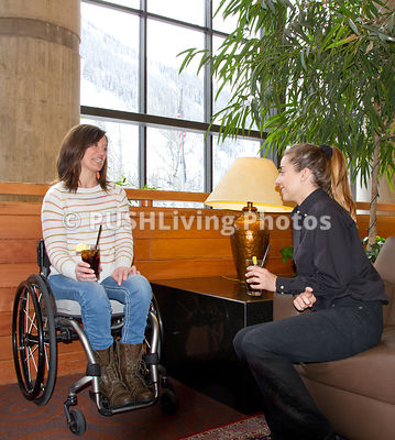Woman in a wheelchair at a ski lodge