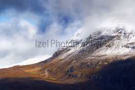 A snow and cloud covered summit of Slioch above Loch Maree in the Scottish Highlands, Scotland, UK.