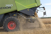 Claas Lexicon 760 combining barley, with straw coming out of rear discharge. Yorkshire, UK.