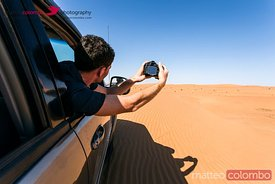 Tourist making a photo during dune bashing, Wahiba sands, Oman