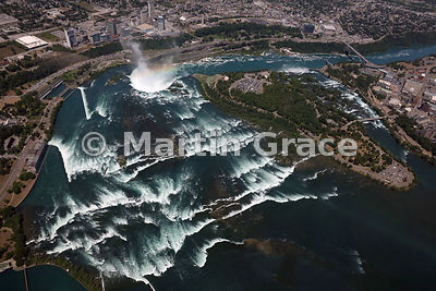 Niagara Falls from the air, showing (from left) the rapids at the outflow of Lake Erie north-west over Canadian Horseshoe Falls (Canada), Goat Island and the American Falls (USA)