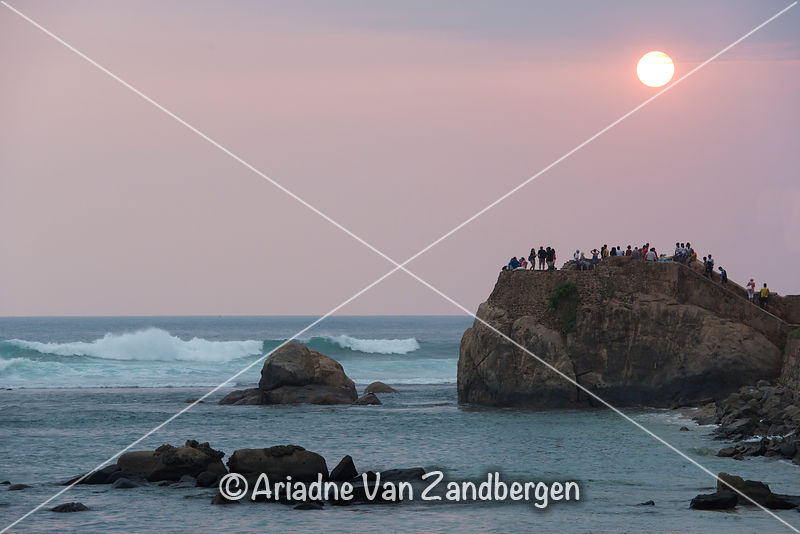 People enjoying the sunset from Flag Rock, the southern most end of Galle Fort, Galle, Sri Lanka