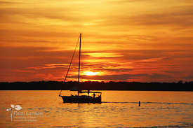 Sailboat in Presque Isle Bay at Sunset