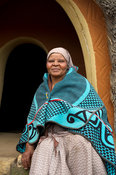 Sotho woman in front of hut, Basotho Cultural Village, Golden Gate Highlands National Park, South Africa
