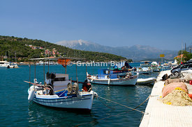 Fishing boats moored in Vathi harbour, Meganisi island, Lefkada, Ionian Islands, Greece