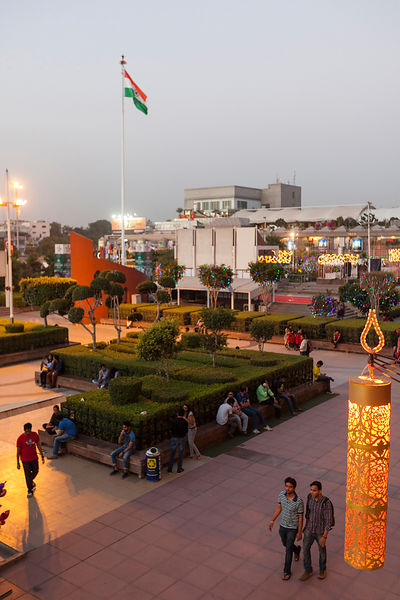 India - Delhi - Shoppers walking through the courtyard of the Ambiance Mall, Saket,