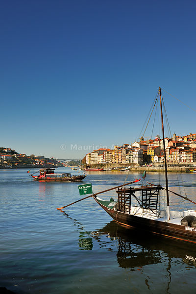 Oporto, capital of the Port wine, and the Ribeira district, UNESCO World Heritage Site. In the foreground the Rabelos boats, Portugal