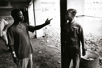 Liberia - Monrovia - Former boy fighter, argues with his girlfriend