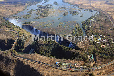 Victoria Falls (Mosi-oa-Tunya) from the air, mostly Zambia but the land and road to the left (west) of Victoria Falls Bridge and the river above is Zimbabwe