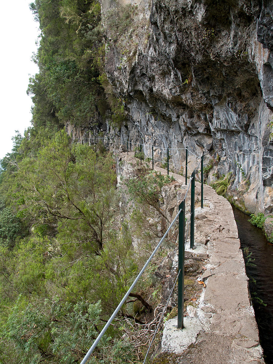 A levada cut into the cliff face. The maintenance path is good for walking