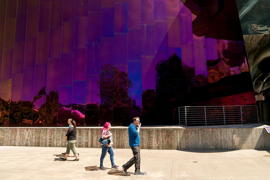 Tourists walk by the Museum of Pop Culture in Seattle, Washington.
