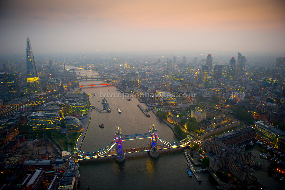 Dusk aerial view of Tower Bridge and River Thames