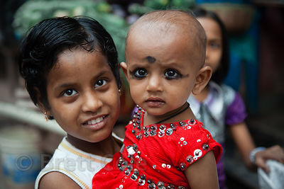 Portrait of a girl and her sister in the Fakir Bagan area of Howrah, India
