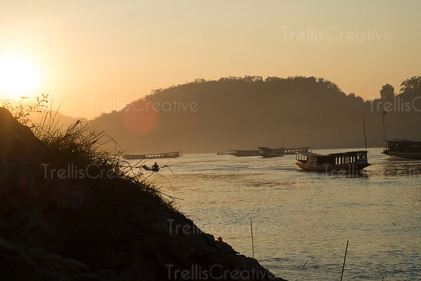 River boat on the Mekong river at sunset in Luang Prabang