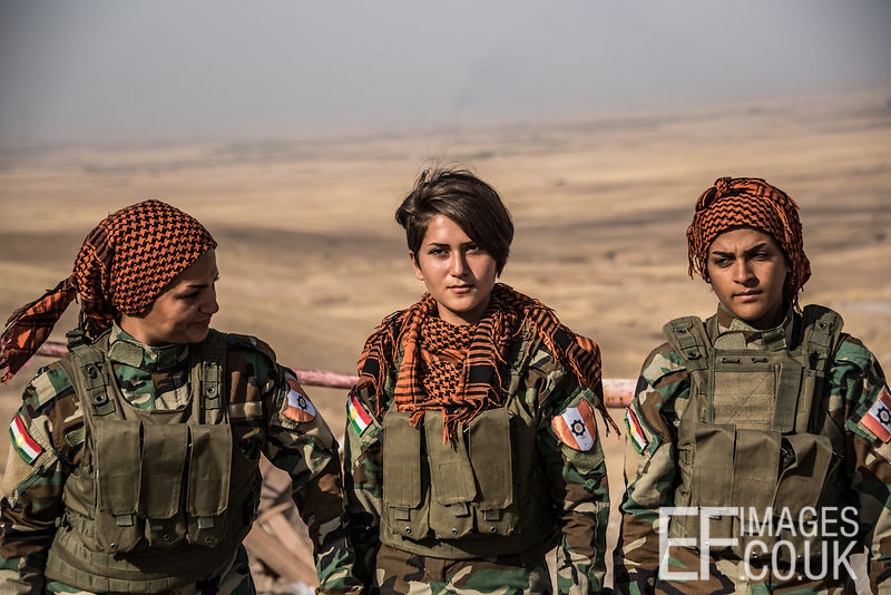 PAK (Kurdistan Freedom Party) female fighters, a mother, daughter and aunty, at their base north of Hawija, where Kurdish Iranian fighters are holding the line against the last vestiges of Daesh and preparing to engage the Hashd al Shaabi forces threatening Kirkuk. Kirkuk Governorate, Iraq, 14th October 2017