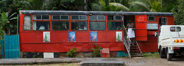 Red bus converted into a cafe, Saint Martin, Mauritius.