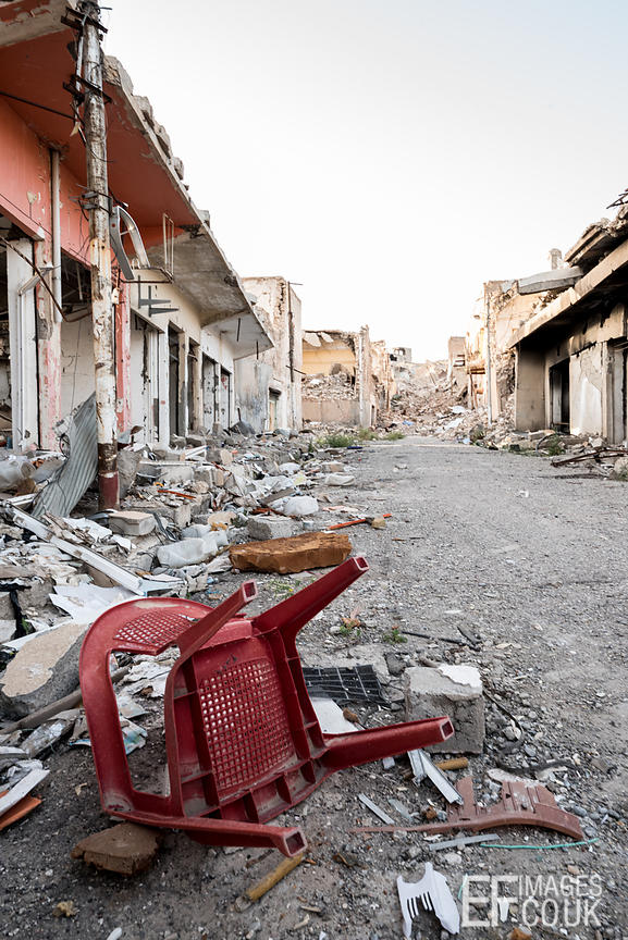 A plastic chair has escaped relatively unscathed on a destroyed street in Sinjar, eighteen months after the city was liberated from ISIS. 10th May 2017