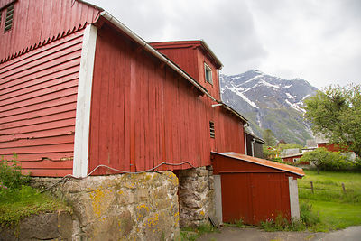 Barn in Summer with Snowy Mountain Behind