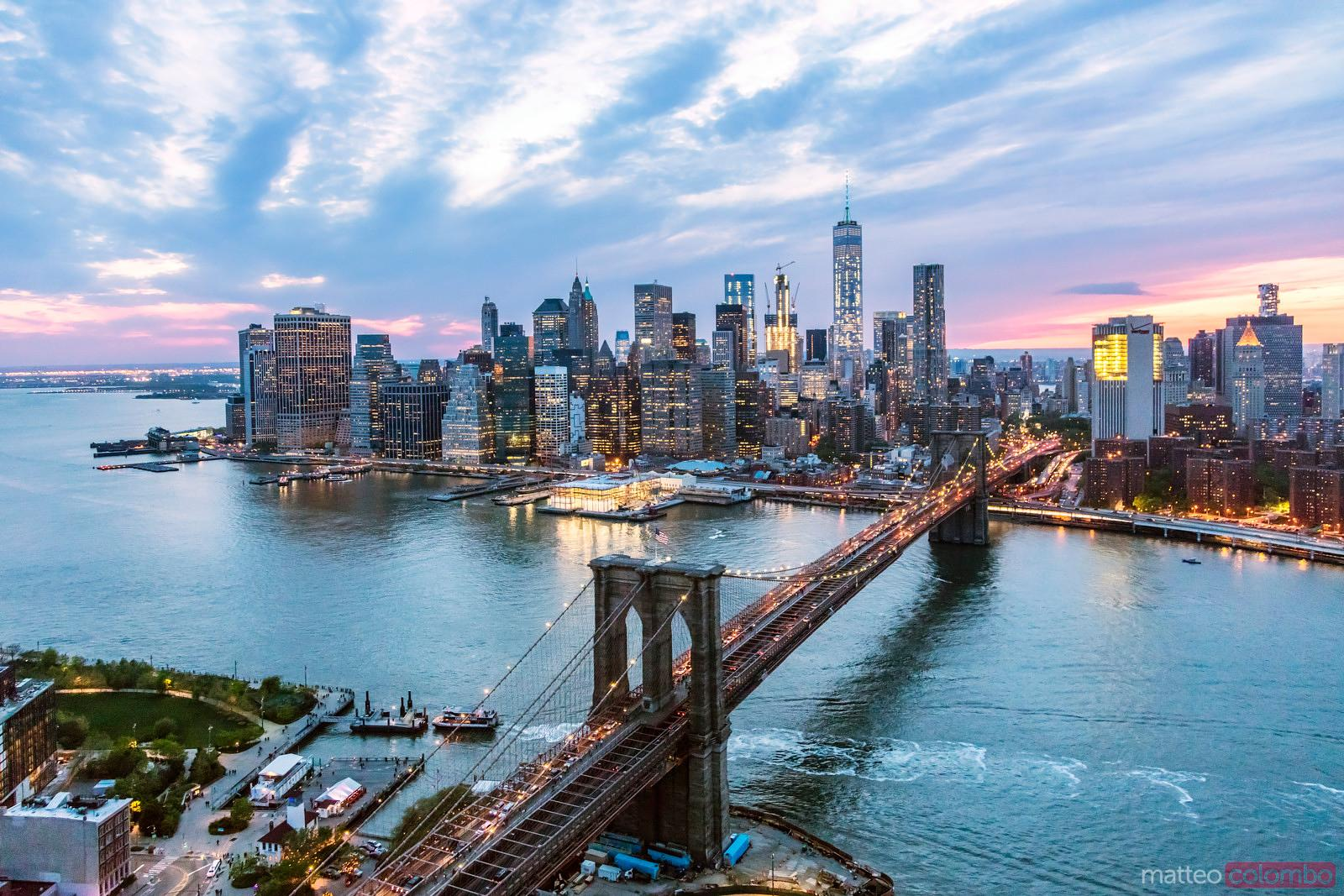Aerial of New York city  and Brooklyn bridge at dusk
