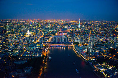 Aerial view of the River Thames at night looking East, London