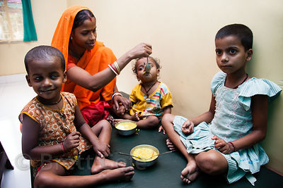Children receive supplemental meals at the Swastha Kendra clinic operated by the NGO Calcutta Kids (calcuttakids.org) in the Fakir Bagan area of Howrah, India