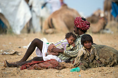 Family relaxing at the Pushkar Camel Fair, Pushkar, Rajasthan, India