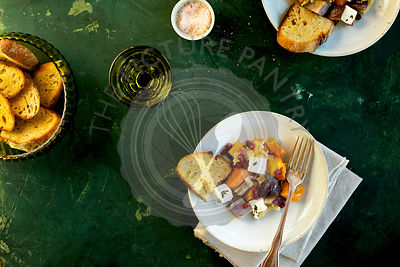 Olive Oil Wine Roasted Vegetable with Feta served with bread and wine.