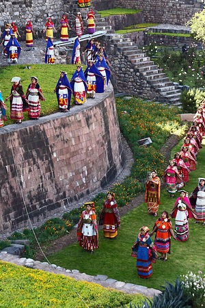 Ñustas / Virgins of the Sun on walls of Coricancha / Sun Temple at start of Inti Raymi festival, Cusco, Peru