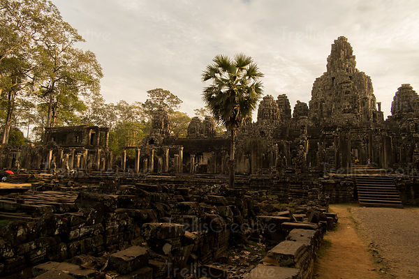 Old ruins and carvings of buddha's face on the bayon temple