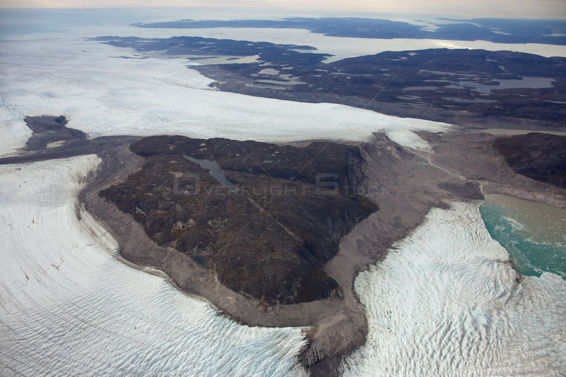 Aerial view of the Sermeq Kujalleq Glacier or Jakobshavn Isbrae, entering the sea, near  Ilulissat Icefjord UNESCO World Heritage Site, Greenland. August 2014.
