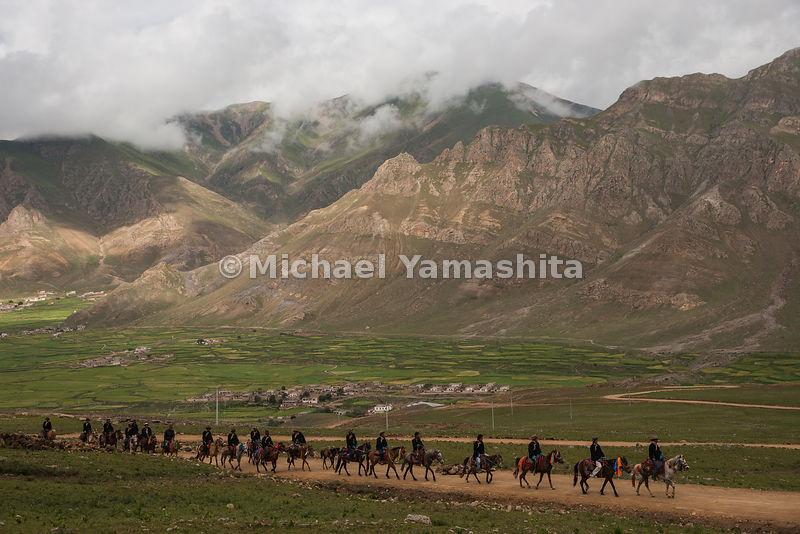 With trucks and motorcycles taking over the jobs of herding and transport, Tibetan cowboys like these in Chiusang, an hour later north of Lhasa, find work as guides for tourist trekkers.