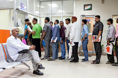 India - New Delhi - People queueing at the Driving Licence authority