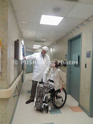 Feamle doctor in a wheelchair discussing a case with her colleague