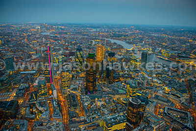Aerial view over the City at night, London